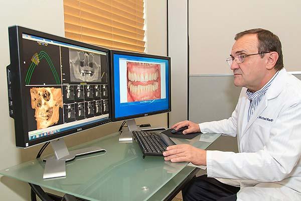 Dentist planning implant treatment