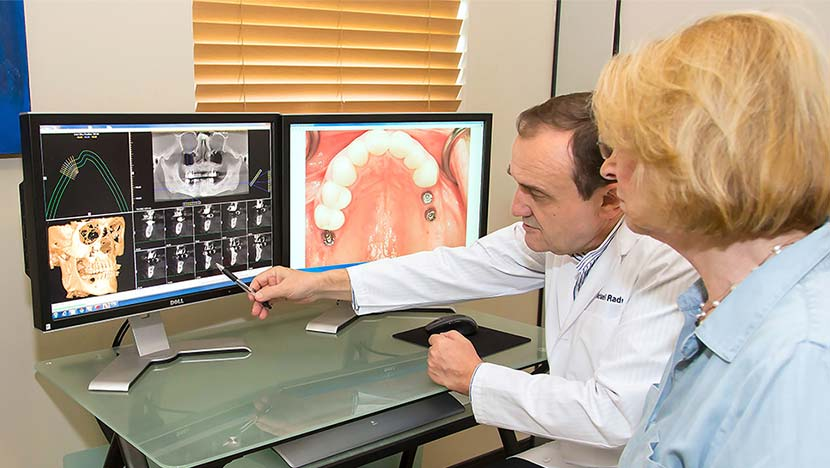 Dentist showing patient implant planning software