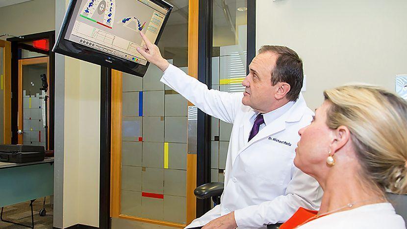 Dentist showing patient TMJ test