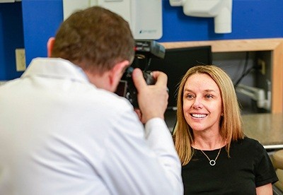 Dentist taking photo of patient's smile