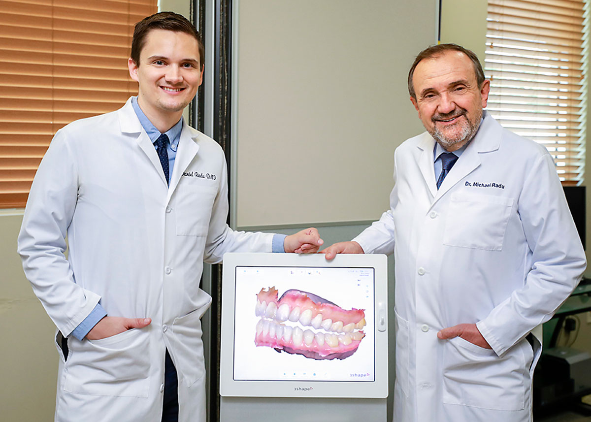 Dentists with digital scanner