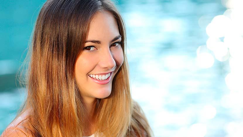 Smiling teenage woman