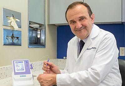 Dentist showing dental laser