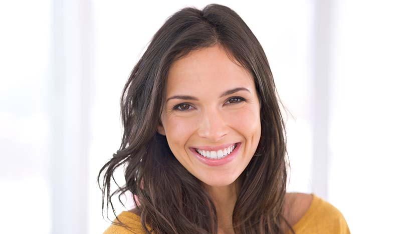 Smiling woman with porcelain veneers