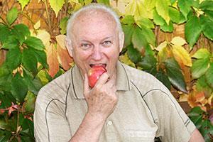 A man eats an apple.
