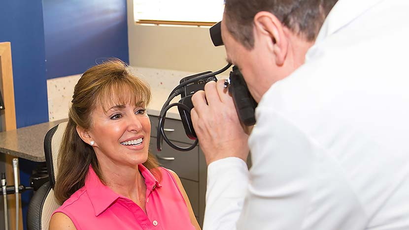 Dentist taking photos of patient's smile